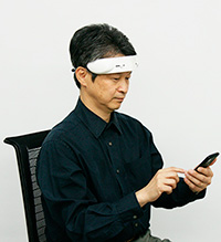 Hitachi High-Technologies' prototype portable brain activity device headband uses NIR and links to a smartphone.